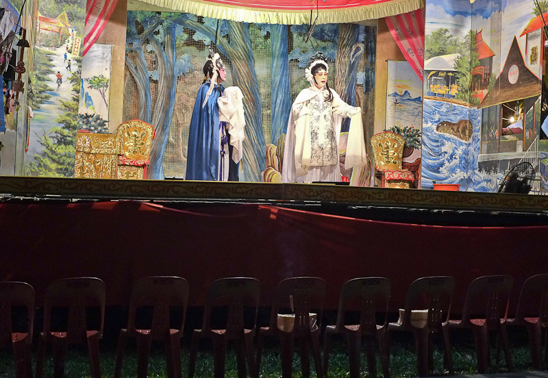 "Chinese Opera getai show with ""empty"" chairs at the front for the spirits."